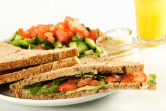 A healthy sandwich. Delicious healthy sandwich with juice Royalty Free Stock Photography