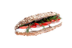 Healthy Sandwich. Sandwich in brown baquette with fetta cheese,tomato, dill isolated on white background stock photo