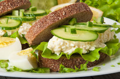Healthy sandwich. With cucumber and egg with cheese for breakfast Stock Photos
