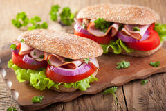 Healthy sandwich with ham tomato and lettuce Stock Images