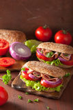 Healthy sandwich with ham tomato and lettuce Royalty Free Stock Photo
