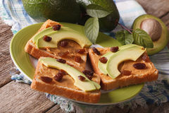 Healthy sandwich with peanut butter, avocados and raisins. horizontal Stock Images