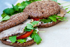 Healthy sandwich with rye bun, beef and vegetables. Stock Photos