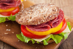 Healthy sandwich with salami tomato pepper and lettuce Stock Images