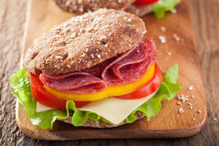 Healthy sandwich with salami tomato pepper and lettuce Royalty Free Stock Image
