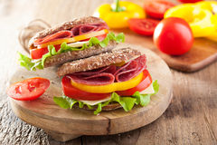 Healthy sandwich with salami tomato pepper and lettuce Royalty Free Stock Photo