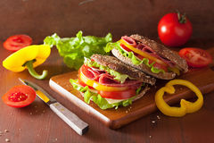 Healthy sandwich with salami tomato pepper and lettuce Royalty Free Stock Photography
