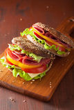 Healthy sandwich with salami tomato pepper and lettuce Royalty Free Stock Images
