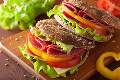 Healthy sandwich with salami tomato pepper and lettuce Stock Photography