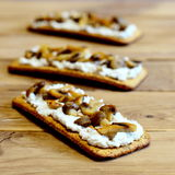 Healthy sandwiches on a wooden table. Open sandwiches with soft cheese and mushrooms on crisp bread. Tasty vegetarian appetizer Stock Photo