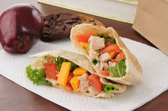 Healthy school lunch. A healthy school or sack lunch with a chicken pita sandwich, apple and cookies Royalty Free Stock Images
