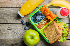 Healthy school lunch box. On rustic background, copy space Royalty Free Stock Images
