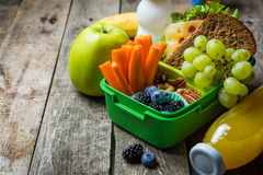 Healthy school lunch box. On rustic background, copy space Stock Images