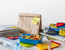 Healthy school lunch in box on white wood table background