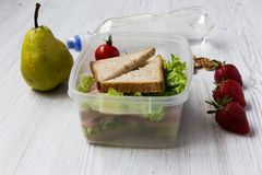 Healthy school lunch box on white wooden background. Side view. Royalty Free Stock Photo