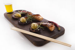 Healthy sea food detail - octopus, olives and pepper. Detail of octopus isolated on plate Stock Photography