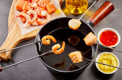 Healthy seafood fondue with dipping sauces royalty free stock photos