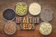 Healthy seed collection in glass bowls Royalty Free Stock Images