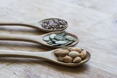 Healthy seeds in spoons Stock Photo