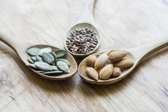Healthy seeds in wooden spoons Stock Images