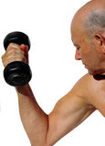Healthy senior. Elderly man lifting weights stock image
