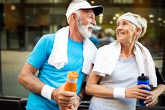 Healthy senior, couple jogging in the city at early morning with sunrise royalty free stock image