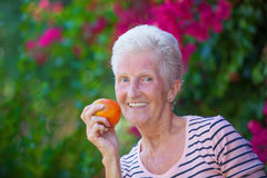 Healthy senior eating apple. Royalty Free Stock Photo