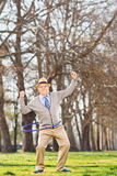 Healthy senior exercising outdoors Royalty Free Stock Image