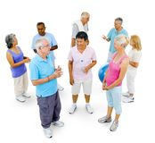 Healthy senior people at the gym on white background stock photos