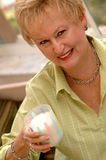 Healthy senior woman. A senior woman holding a glass of milk Royalty Free Stock Photography