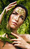 Healthy sensual woman with plant around face Stock Image