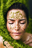 Healthy sensual woman with plant on face Stock Photography