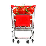 Healthy shopping concept - shopping cart with tomatoes Royalty Free Stock Photography