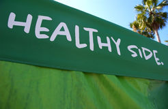 Healthy side. Green healthy side tent and palm trees Royalty Free Stock Photo