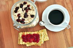 Healthy, simple breakfast with cranberries and coffee Royalty Free Stock Image