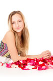 Healthy skin, a beautiful girl lies in rose petals Stock Photo