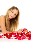 Healthy skin, girl lies with petals Royalty Free Stock Images