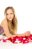 Healthy skin, the girl lies with rose petals Stock Photography