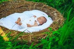 Healthy sleep of newborn baby. Newborn sleep without swaddle. Healthy growth and development. Baby girl or boy awake. After sleep in crib. Sleep helps your stock image