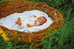 Healthy sleep of newborn baby. Newborn sleep without swaddle. Healthy growth and development. Baby girl or boy awake. After sleep in crib. Sleep helps your stock photos