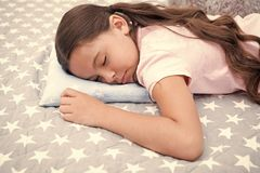 Healthy sleep tips. Girl sleeps on little pillow bedclothes background. Girl child long hair fall asleep pillow close up. Quality of sleep depends on many royalty free stock photo