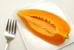 Healthy slice of papaya fruit Stock Photos