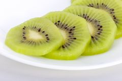 Healthy Slices. Kiwifruit slices on plate Royalty Free Stock Photography