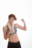 Healthy slim woman showing muscles. Stock Image