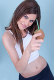 Healthy slim young woman, holding a straw in kiwi Royalty Free Stock Photo