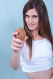 Healthy slim young woman, holding a straw in kiwi Royalty Free Stock Photos