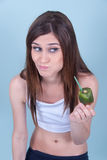 Healthy slim young woman, holding a straw in kiwi Stock Images