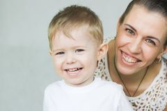 Healthy smile. a happy family. Mother and child on a white background smiling Stock Photos