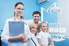 Healthy Smiles. Family at a reception at the dental clinic Royalty Free Stock Photos