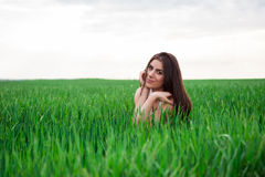 Healthy Smiling Girl in Green Grass. Royalty Free Stock Image